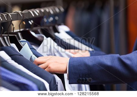 Male hand choosing a shirt