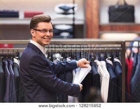 Young man in a suit indoors
