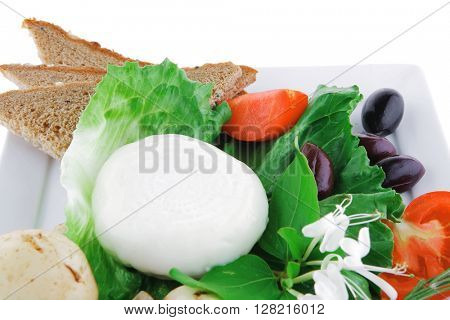 white cheese and bread with olives and tomatoes
