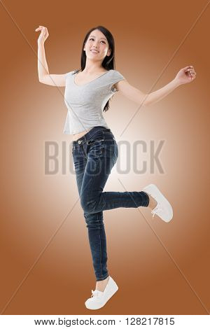Cheerful Asian woman, full length portrait isolated