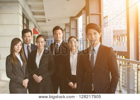 Successful business team of Asian in the city.