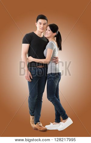 Attractive young Asian couple, full length portrait isolated on white background.