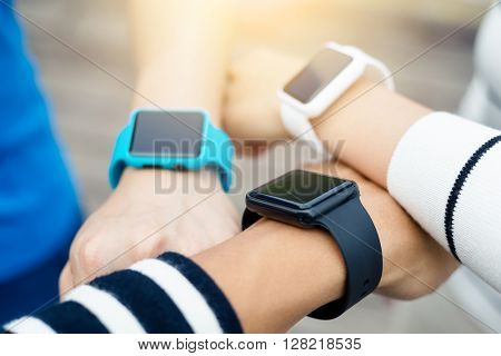 Friends using smart watch together at outdoor