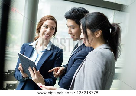 Business team discuss on digital tablet