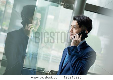 Businessman pick up a call