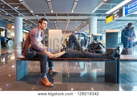 FRANKFURT, GERMANY - MARCH 13, 2016: people at Frankfurt Airport. Frankfurt Airport is a major international airport located in Frankfurt and the major hub for Lufthansa