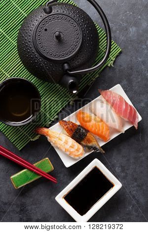 Set of sushi and green tea on stone table. Top view