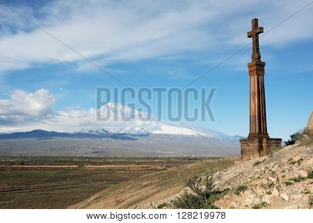 Christian cross in ancient monastery Khor Virap near Turkish-Armenian border in front of Ararat mountain