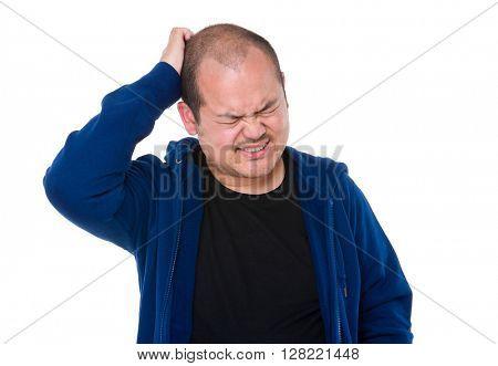 Asian man scratching head