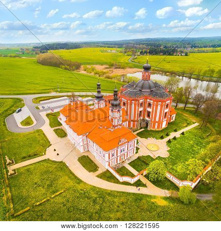 Aerial view of Marianska Tynice - The Pilgrimage Church of the Annunciation of Our Lady. Baroque architecture in rural landscape. Beautiful landmark in Czech Republic, Europe.