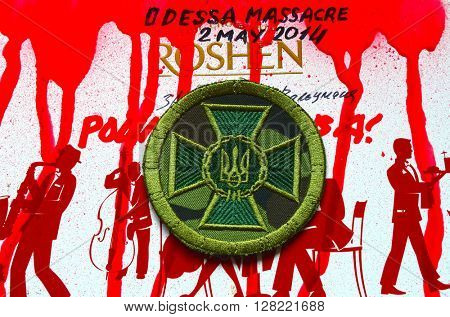 ILLUSTRATIVE EDITORIAL.Chevron of Ukrainian nazionalist battalion. With logo Roshen Inc. Trademark Roshen is property of Ukrainian president Poroshenko. At May 2,2016 in Kiev, Ukraine