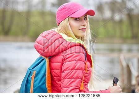 young woman Hiking In The Wild Nature