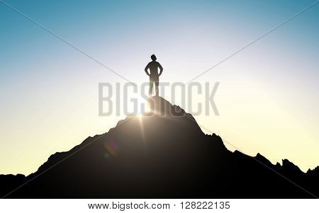 business, success, leadership, achievement and people concept - silhouette of businessman on mountain top over sky and sun light background