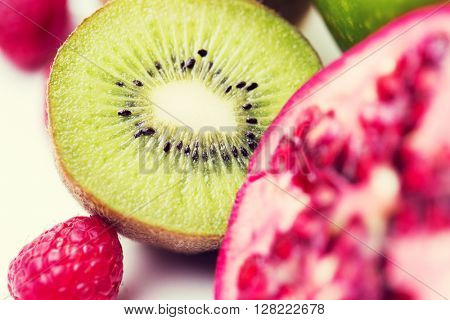 healthy eating, food and diet concept- close up of ripe kiwi and other fruits