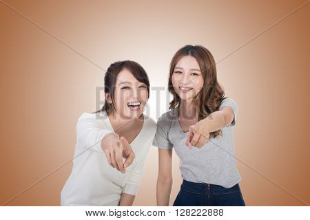 Asian woman laughing and pointing, closeup portrait.