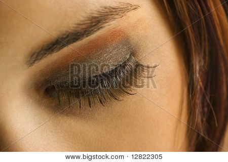 Close up of young Caucasian woman's eye with makeup.
