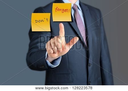 Businessman touching Dont Forget word. business concept