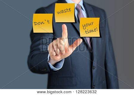Businessman touching words Dont waste your time . business concept