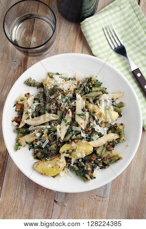 Pasta, potato, and green beans with pesto and Parmesan cheese