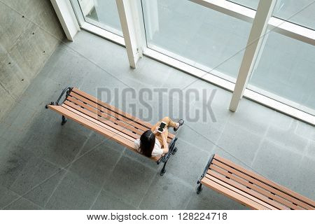 Top view of woman using cellphone