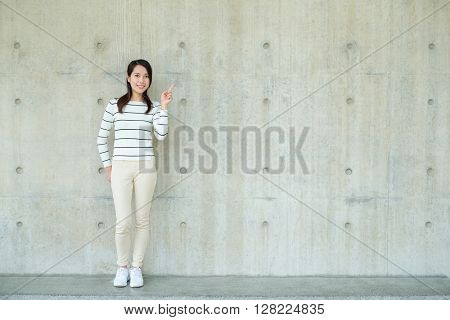 Woman showing finger point up