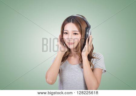 Woman enjoy the music by using earphones.