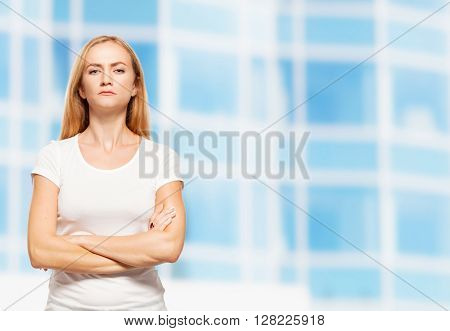 Serious businesswoman on the background of glass office building. Young sad female outdoors