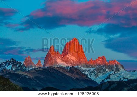 Amazing Patagonia in February. Sharp tops fantastically beautiful cliffs Fitz Roy crimson light rays of sunset