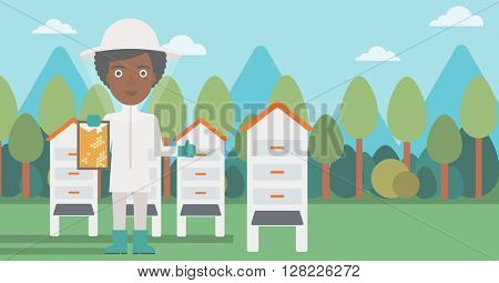 Bee-keeper at apiary.