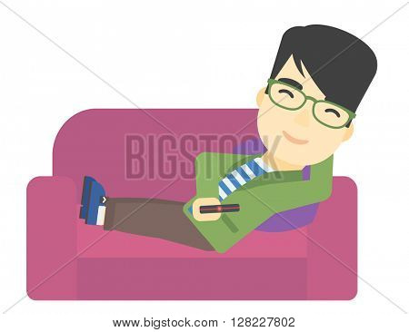 Man sitting on the couch with remote control.