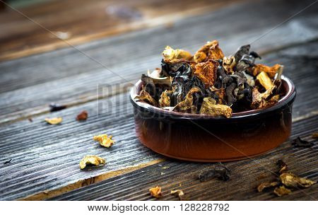 Dried Mushroom On Wooden Background
