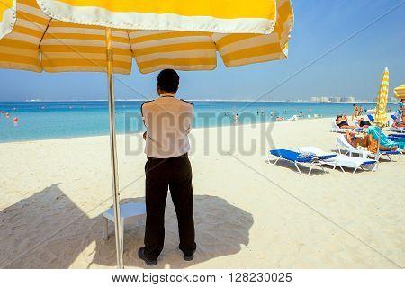 Dubai U.A.E. - November 15 2006: An overseer on the beach of the Oasis resort in the new Marina quarter