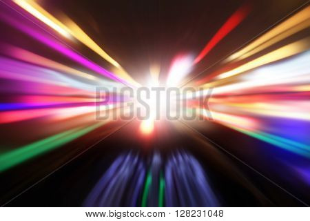 Abstract motion blurred image of car driving fast at night.