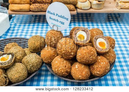 London United Kingdom - April 30 2016: Maltby Street Market in Bermondsey (located in railway arches SE1 Rope Walk). Great artisan street food stalls and bars. Black pudding Scotch egg