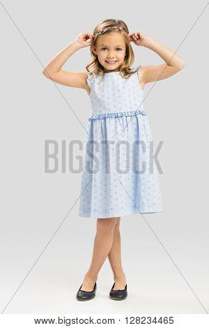 Portrait of a cute happy little girl wearing a princess crown