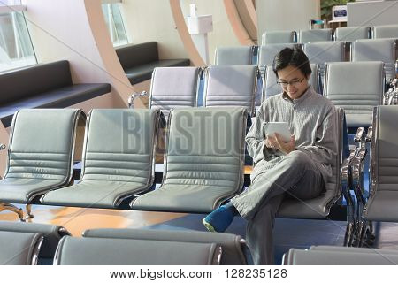 man sit and use a pad in the station