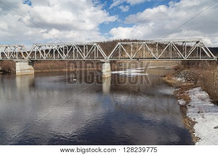 Steel railway bridge over the river Chulman in South Yakutia Russia