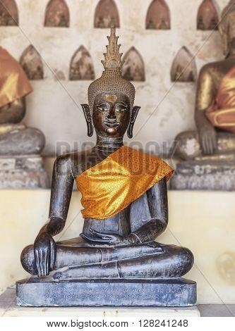 Bronze buddha statue in Wat Si saket Vientiane Laos
