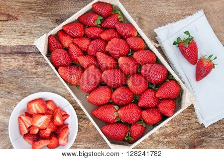 Beautiful large strawberries on a wooden table