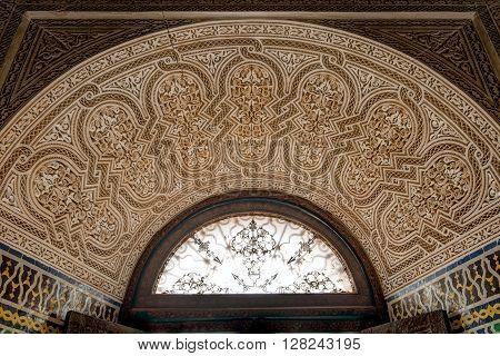 TELOUET, MOROCCO - OCTOBER 22, 2015: Fine Islamic filigree work above a window in the Kasbah of Glaoui in Telouet Morocco.
