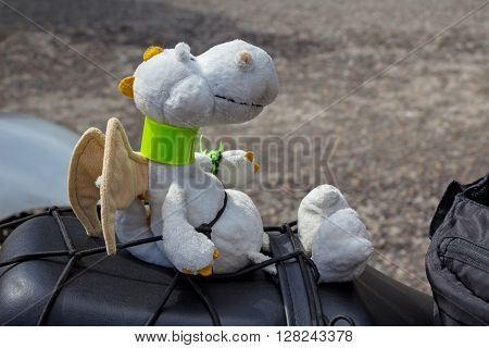 oscow Russia - April 23 2016: Motorcyclists open the spring season. Toy dragon on a motorcycle seat.
