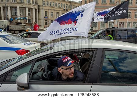 Moscow Russia - April 23 2016: Motorcyclists open the spring season. The group of motorcyclists on the road. Russian riders. Flag motorcyclists society.