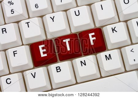 Exchange Traded Funds online A close-up of a keyboard with red highlighted text ETF