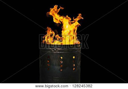 Fire flames burning in bucket isolated in black background