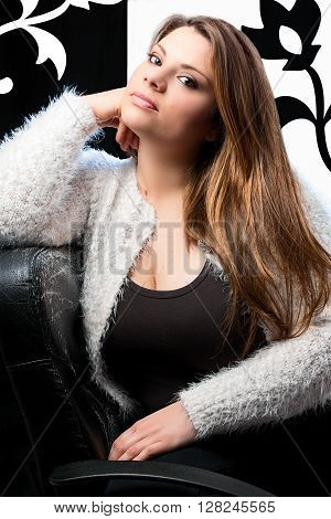 blond woman on chair with back and white background