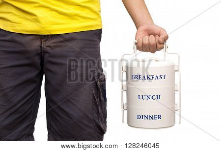 School boy standing and hold food carrier on white background