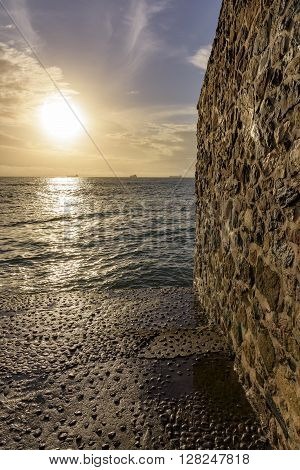Sunset in an old stone pier in Solar Unhão the city of Salvador and the edge of the waters of the Bay of All Saints