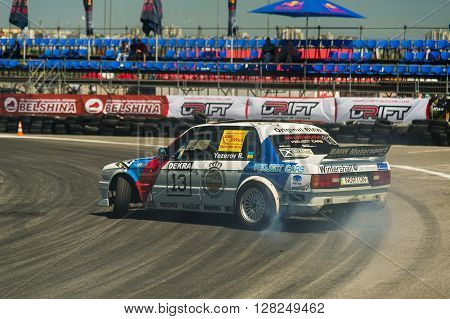 Lviv Ukraine - Juny 6 2015: Rider Ruslan Yezerov on the car brand BMW overcomes the track in the championship of Ukraine drifting in Lviv.