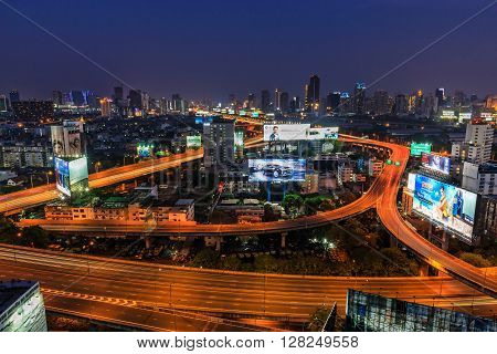 BANGKOK THAILAND - 16 APRIL 2016 - Scene of Bangkok elevated expressway and high-rise buildings at dusk.