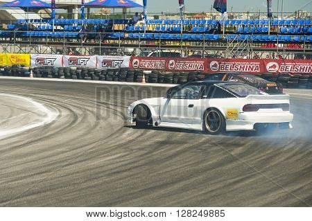 Lviv Ukraine - Juny 6 2015: Unknown riders on the car brand Nissan overcomes the track in the championship of Ukraine drifting in Lviv.